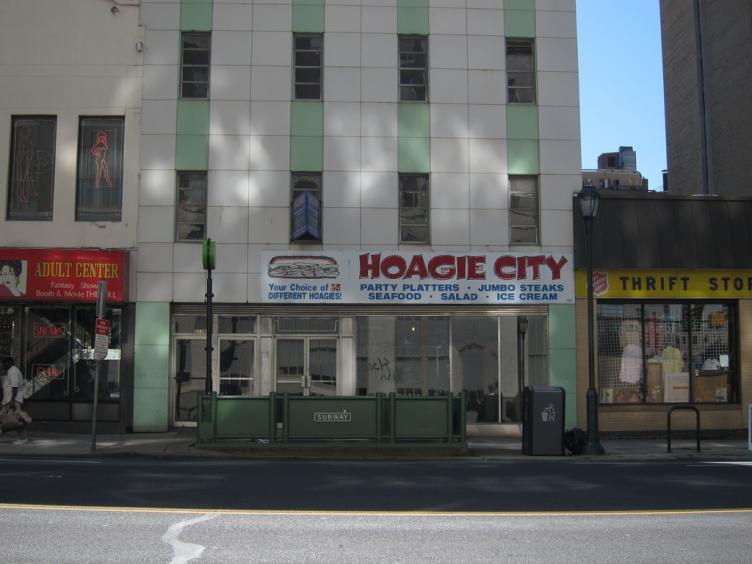 The Hoagie City building is the one that collapsed, crushing part of the thrift store next door, during demolition. | Flickr user: sameold2010