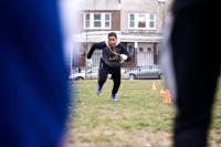 National championship-winning NW Raiders youth football team practices on a patchy city-owned field in East Germantown.  (Bastiaan Slabbers for WHYY)
