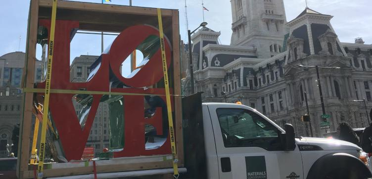The restored LOVE statue makes its way back to LOVE Park.