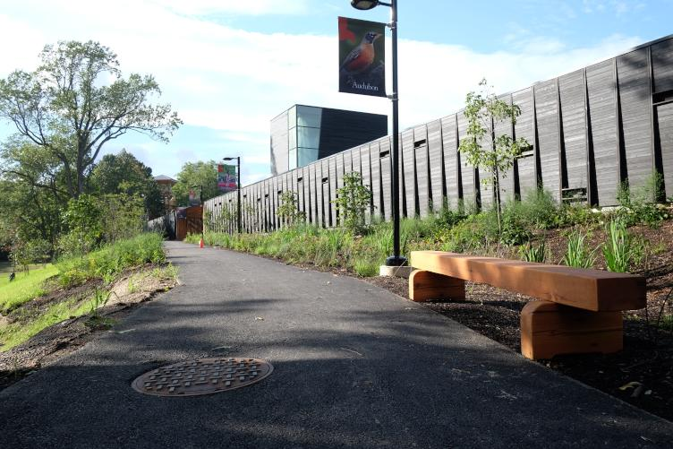 The walk up to the Discovery Center is a build-up for the reservoir behind the long wall. | Ashley Hahn for PlanPhilly