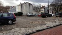 This small lot at 147 Gay Street — which offers spots for 30 vehicles — has become a flash point pitting residents against developers. (Neema Roshania/WHYY)