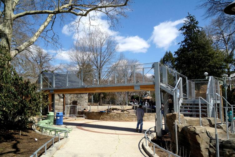 To enter the zoo and learning center, guests walk under an overhead goat bridge, Photo courtesy of SMP Architects