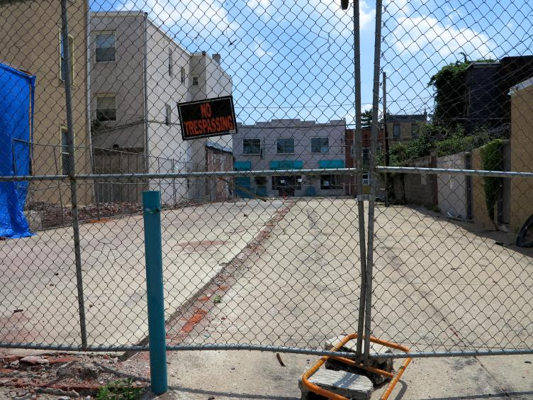 Cleared lot slated for garage-fronted rowhouses, 700 block of Kater looking toward Bainbridge