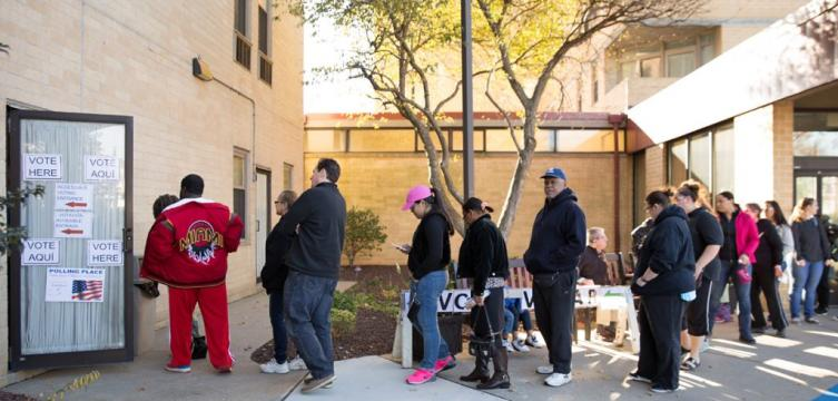 Voters line up outside the polls on Election Day  in 2016. (WHYY)