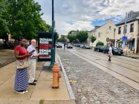 Kelli McIntyre and Andy Trackman check out walking conditions along Germantown Avenue during a FeetFirstPhilly walk audit.